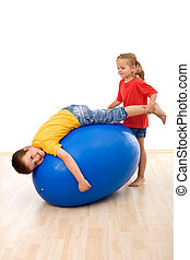 Kids having fun playing with a large rubber ball