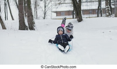 Kids Having Fun with Sledges on Snowy Hill - Kids having fun...