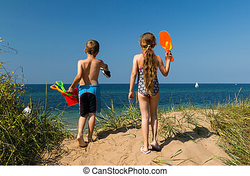Kids heading to the beach