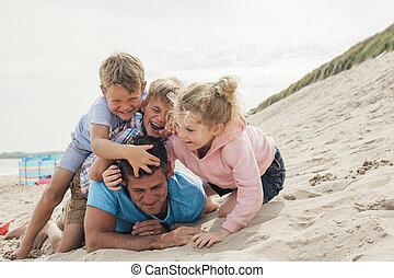 Kids Holding Dad Down