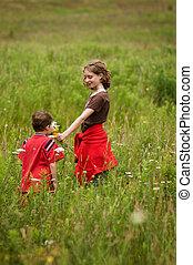 kids in a wildflower field