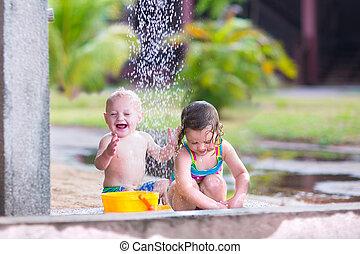 Kids in an outdoor shower