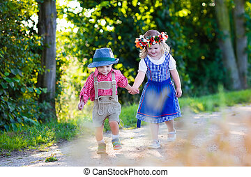 Kids in Bavarian costumes in wheat field - Kids in...