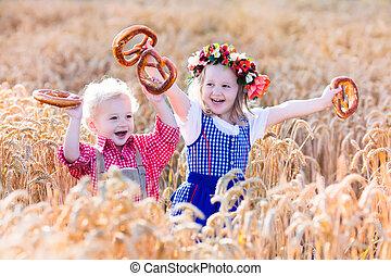 Kids in Bavarian costumes in wheat field - Kids in ...