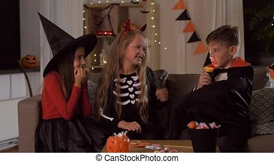 kids in halloween costumes playing at home - halloween, ...