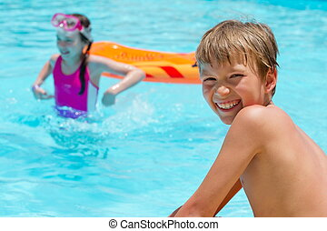 Kids in pool  - Brother and sister in swimming pool.
