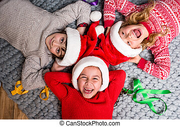 kids in Santa hats lying in circle