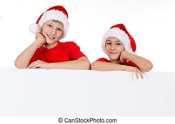 kids in santa hats with board