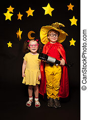 Kids in sky watchers costumes with a telescope