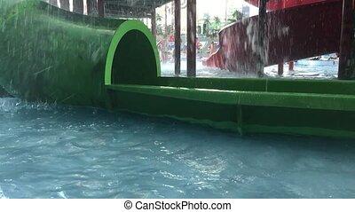 Kids in swimming pool. Girl swim outdoors.