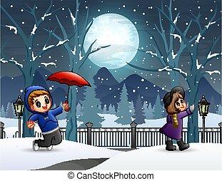 Kids in the winter night landscape