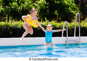 Kids jumping into swimming pool - Happy little girl and boy...