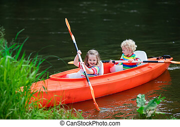 Kids kayaking in summer sport camp