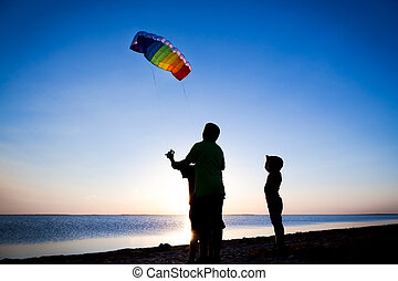 kids launching the rainbow kite together