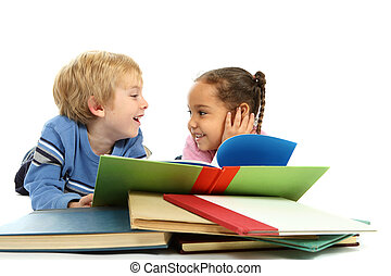 Two young children laugh as they read books