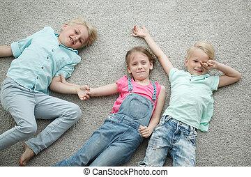 Kids laying on floor