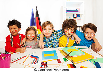 Kids learning languages sitting in line at a desk