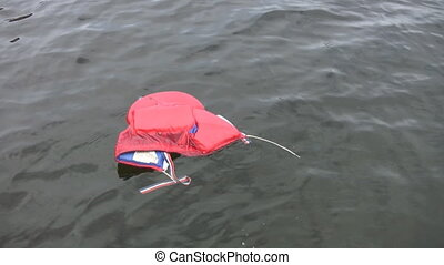 Kid's Lifejacket. - A childs lifejacket floats in the lake.