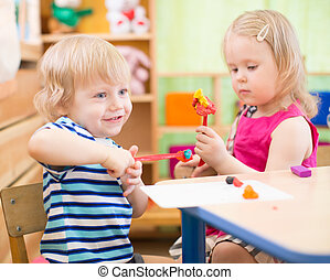kids making arts and crafts in kindergarten with interest -...