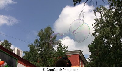 Kids making giant soap bubbles