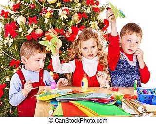 Kids making Santa card for Christmas.
