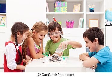 Kids observing a science lab project at home - Kids...