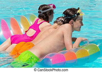 Kids on a pool float