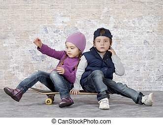Kids on a skateboard