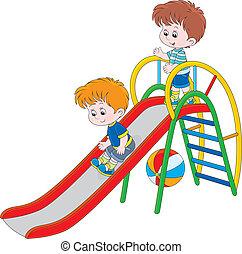 Little boys sliding down on a playground
