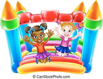 Kids on Bouncy Castle - Two little girls having fun jumping...