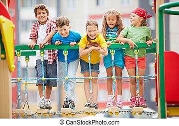 Kids on playground - Happy friends having fun on playground