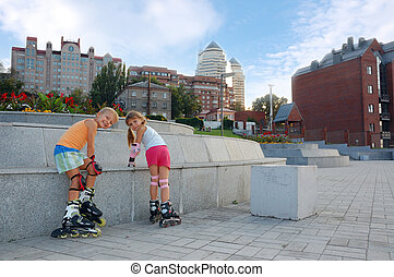 kids on roller blades in the park