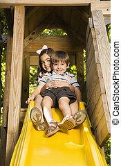Kids on slide.