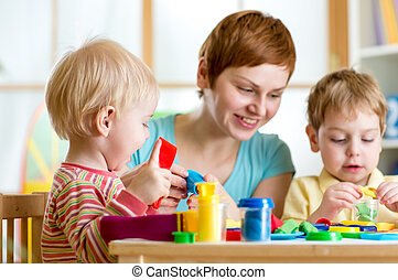 kids or children and mother play colorful clay toy - mother...