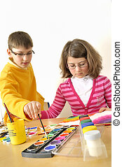 kids painting with watercolor