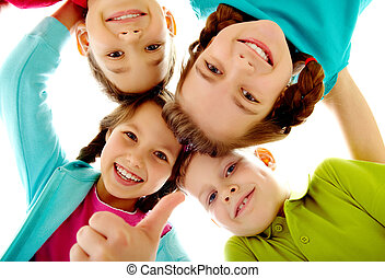 Kids - Photo of joyful children touching by their heads with...
