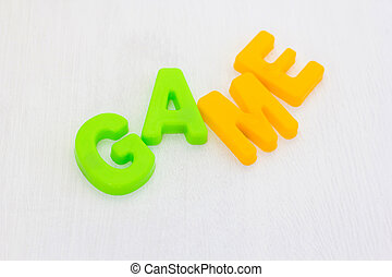 Kids plastic toy colorful letters on white background, Phrase game. Learning english words in language school
