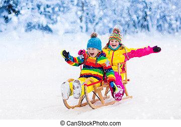 Kids play in snow. Winter sleigh ride for children - Little...