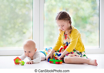 Kids playing at home - Kids playing together at home. Little...