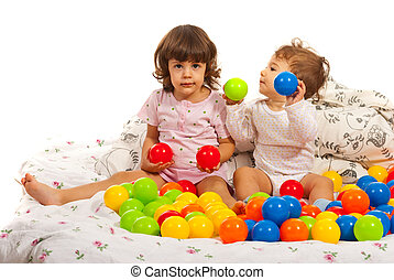 Kids playing in bed with balls