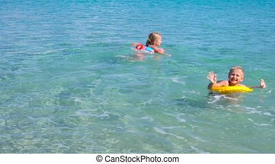 kids playing in water at beautiful tropical beach - kids...