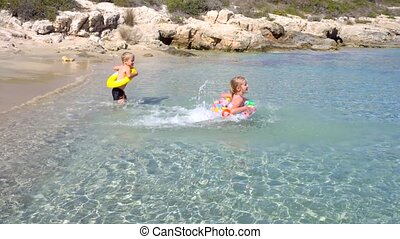 kids playing in water at beautiful tropical beach