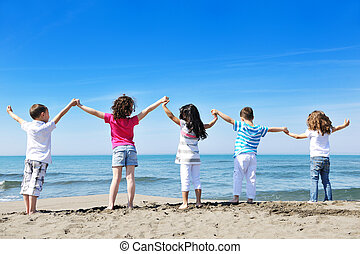 kids playing on beach - happy child kids have fun and play ...