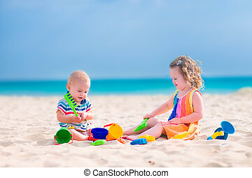 Kids playing on the beach - Happy baby boy and little curly...
