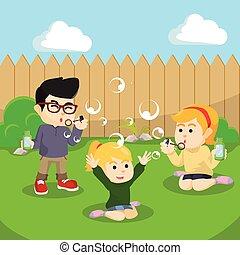 kids playing soap bubbles at the backyard