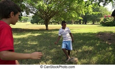 kids playing soccer football park - Sports, children, young...