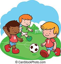 kids playing soccer - Three little boys play football.