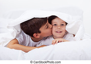 Kids playing under the quilt