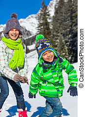 Kids playing winter.