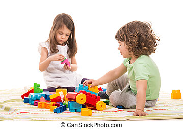 Kids playing with bricks toys